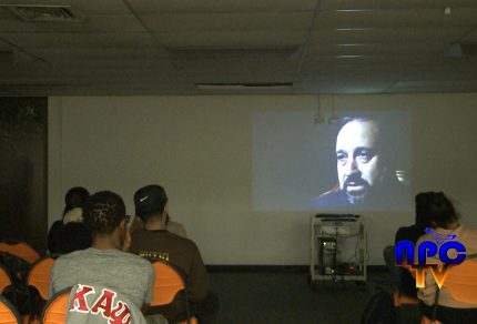 Picture of students watching a documentary