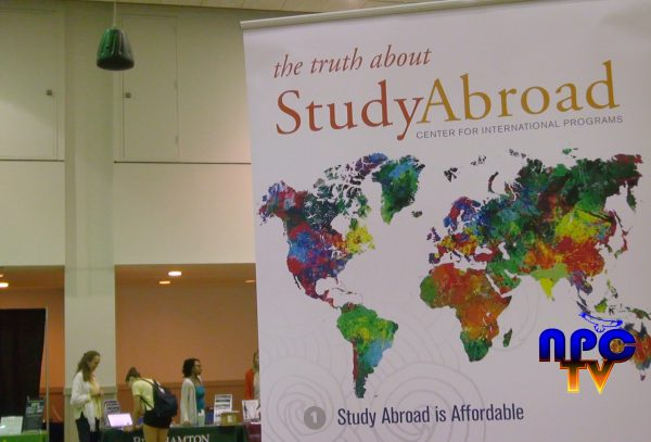 "The photo is taken place in the Multi Purpose Room in the Student Union Building where the Study Abroad Fair took place. The sign in the picture says, ""The truth about study abroad Center for International Programs. The npc-tv logo is located in the lower right corner of the image."